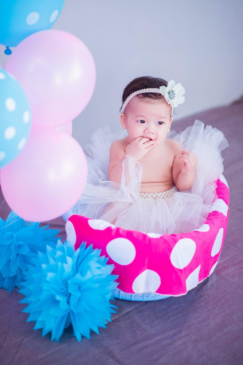 cute baby in a pink design baby hamper