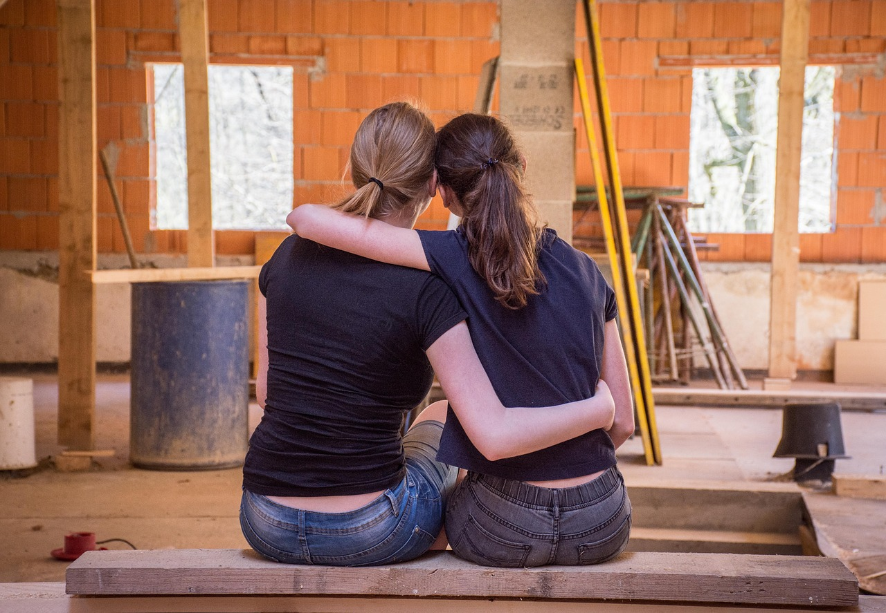 two girls doing a DIY home improvement