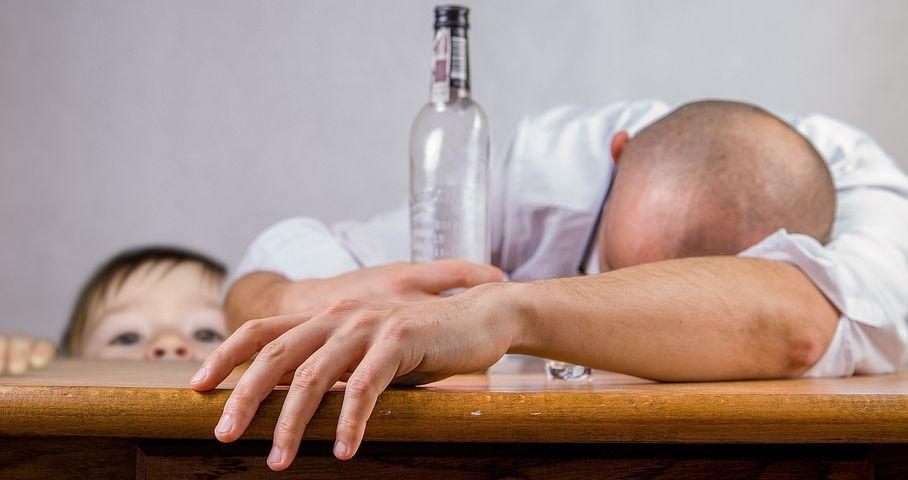 man depressed and drinking