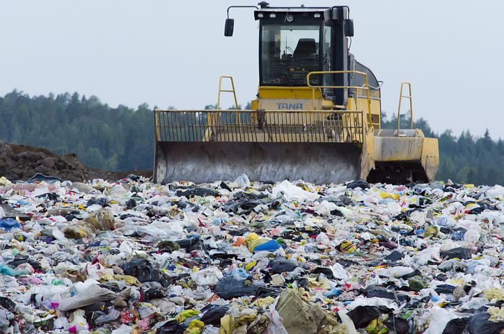 garbage truck in a landfill