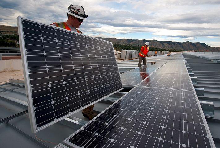 Two men providing solar panel financing solutions